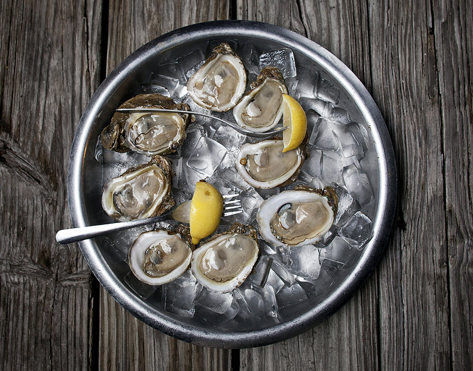 A classic plate of raw oysters served on ice with lemons at Boss Oyster House. (Photo by Jeremiah Stanley)