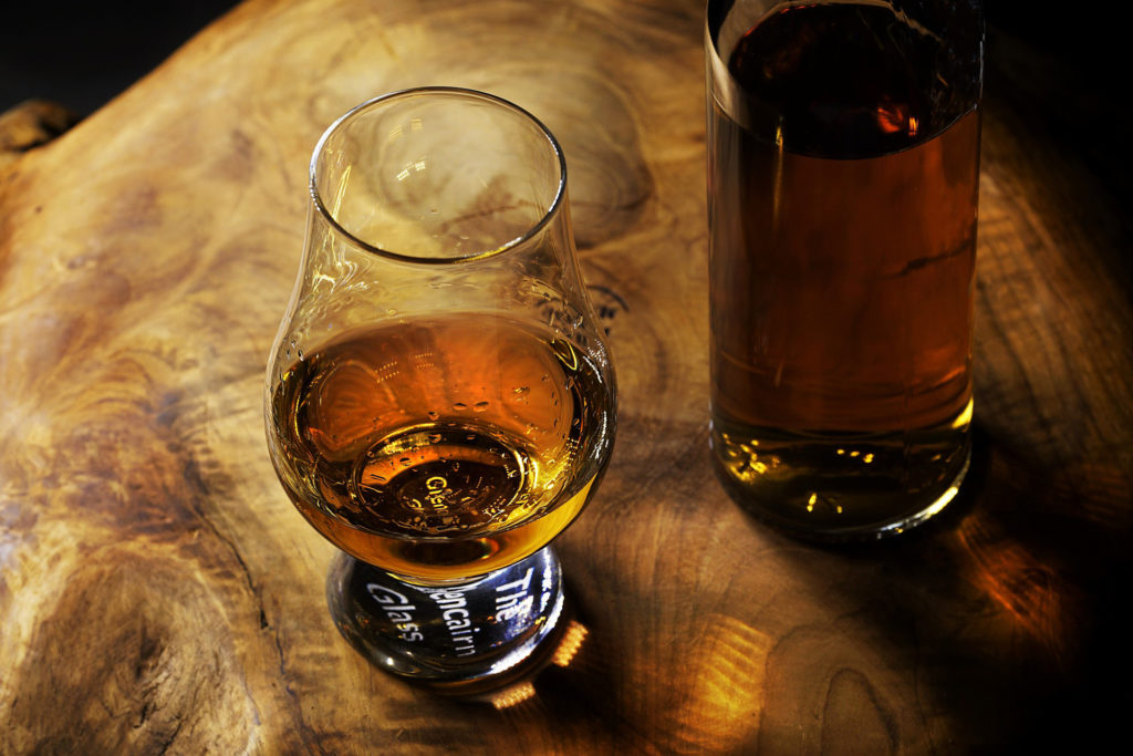 Whisky glass and bottle