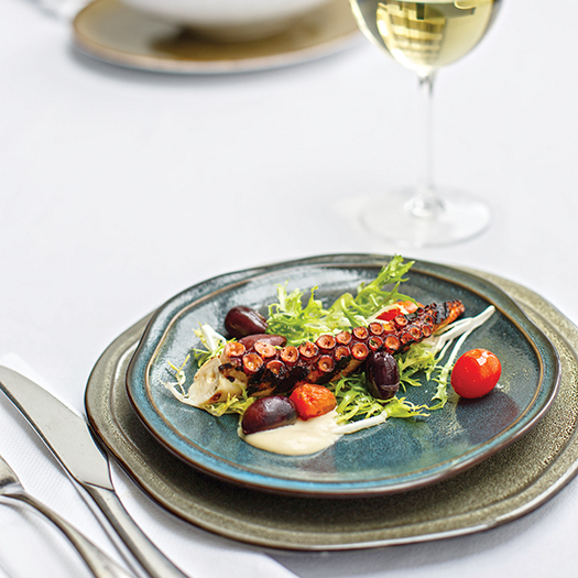 Grilled octopus with chickpea puree and salad: Photograph by Jessie Prezza