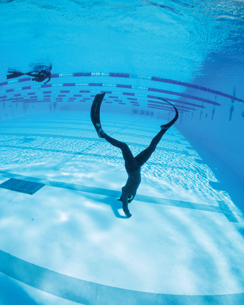 Freediving students learn kick cycles to conserve energy and wear long, light fins for greater efficiency. Photograph by Performance Freediving