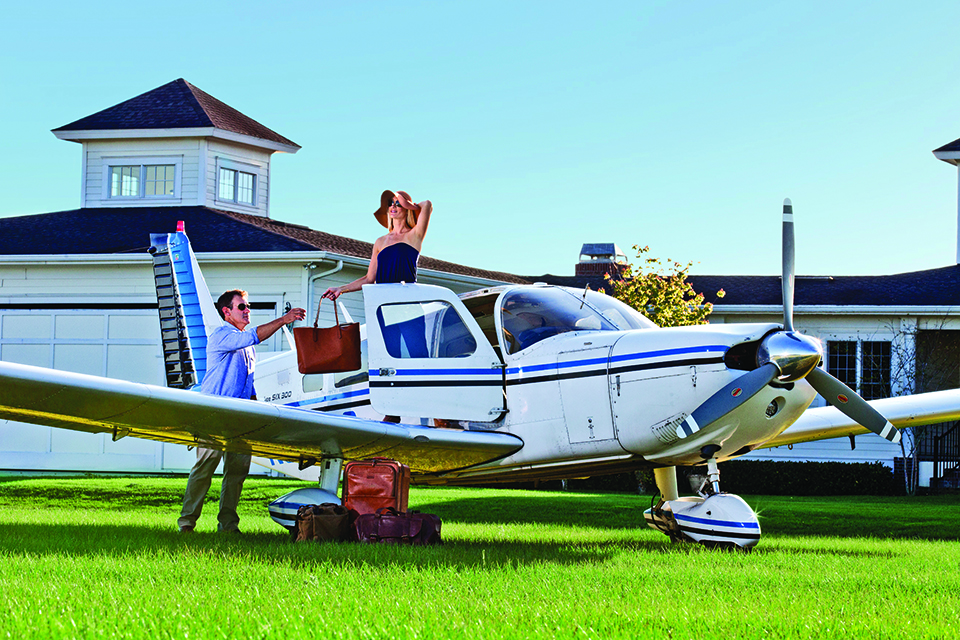 Christina and Jamie Clifford disembark a 1974 PA32 Piper Cherokee Six, at Grass Roots Airpark in Groveland. Photograph by Jeremiah Stanley