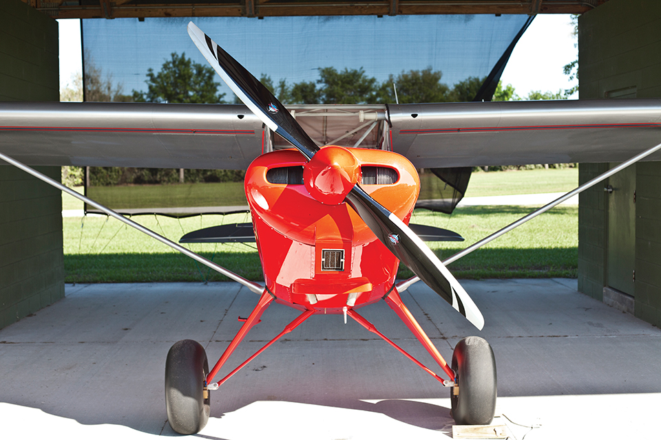 A kit-built airplane parked under a shade-hangar at Grass Roots Airpark in Groveland; Photograph by Jeremiah Stanley