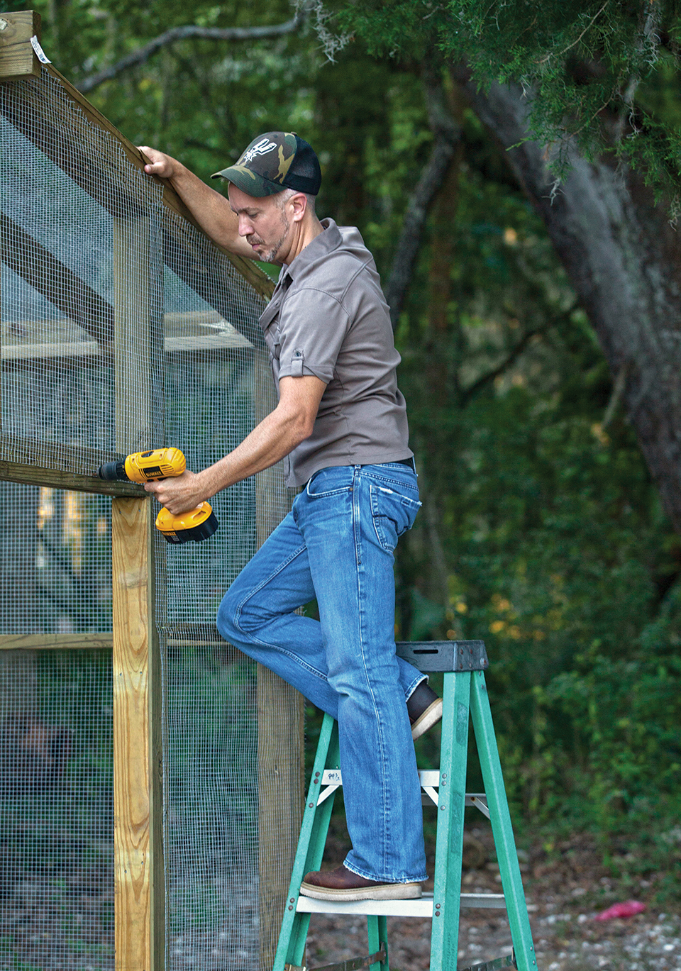 Grey works on building a new chicken coop for the 14 chickens he keeps at home.