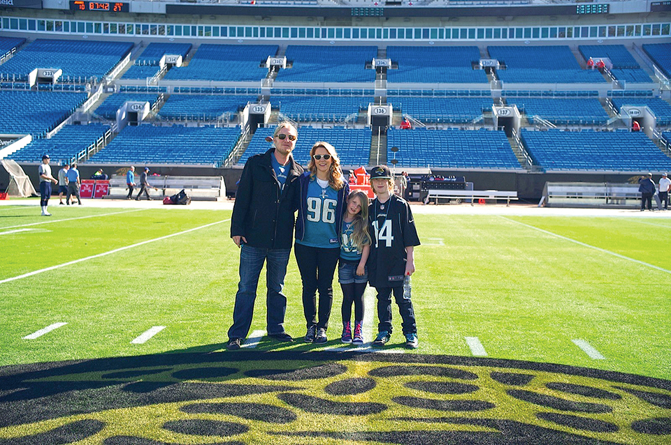 The singers pose with their children after a Jaguars game. Photography by Tedeschi Trucks Band