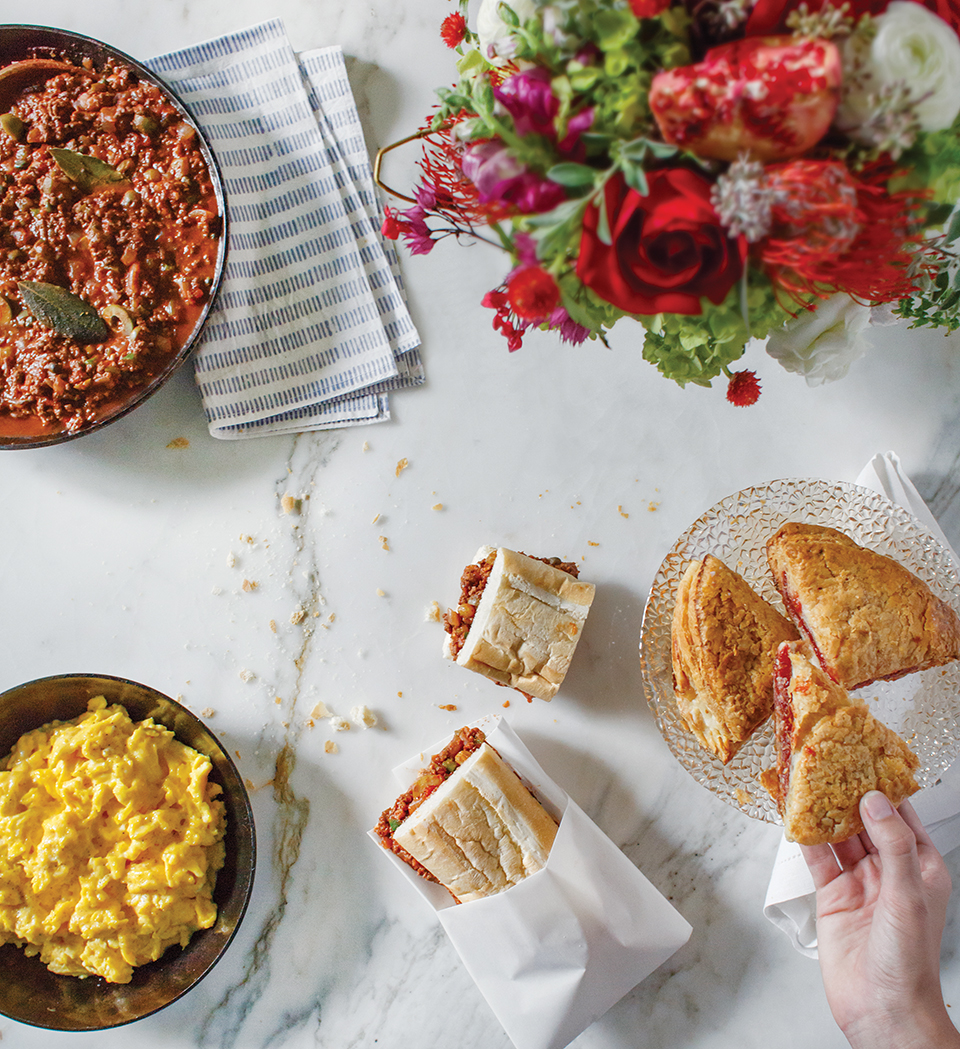 Gasparilla Brunch (clockwise): scrambled eggs, picadillo, guava tarts, picadillo on cuban bread; Photography by Jessie Preza; Flowers by Mardee Morris