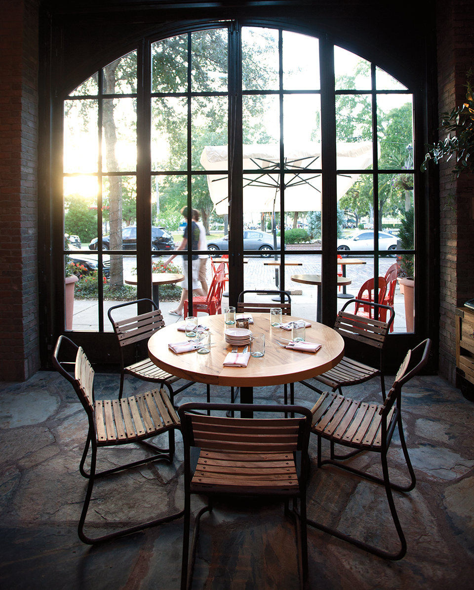 A table set for six overlooks a bustlingWinter Park shopping district; Photography by Michael Pisarri