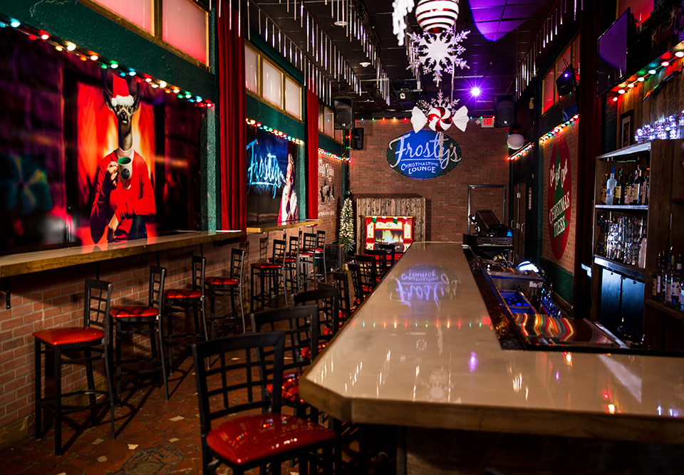 Enjoy a cocktail over a snowcone at the lower bar at Frosty's Christmas Lounge; Photography by Corey Besteder