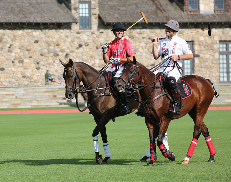 Phillips riding with friend and fellow player Nic Roldan at the Greenwich Polo Club in Greenwich, Ct. Photography by United Staes Polo Association