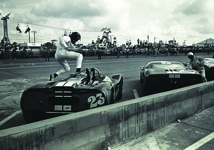 A driver leaps into his car at the start of the 1965 Sebring. Photography by Ken Breslauer Sebring Raceway Archives