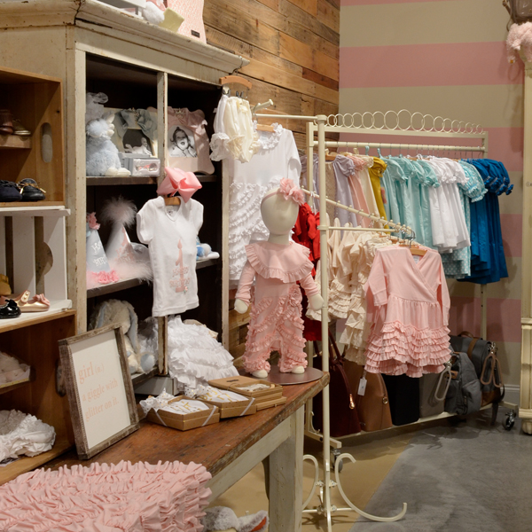 This shabby-chic boutique carries diaper bags, blankets, toys, accessories and apparel sized for newborns to tweens and available at various price points. Photography by Little Jill and Co.