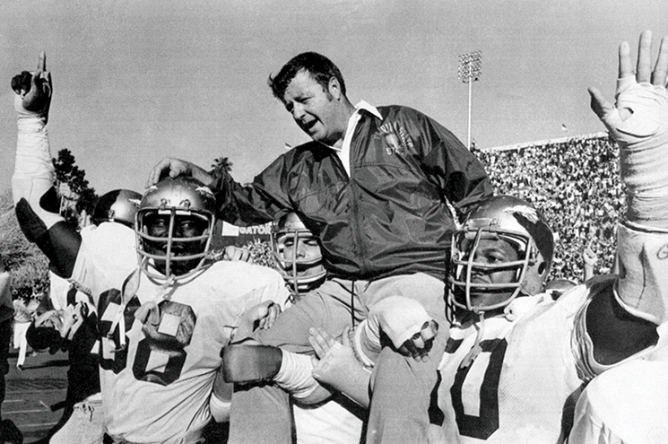 Bobby Bowden is carried on the shoulders of defensive end Willie Jones (88) and nose guard Ron Simmons (50) after Florida State defeated Florida 37-9. Photography by FSU Sports Info