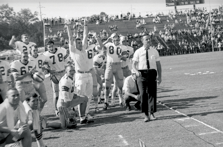 Bowden (as FSU offensive ends coach) at a game vs. the University of Kentucky in 1964; Photography by State Archives of Florida