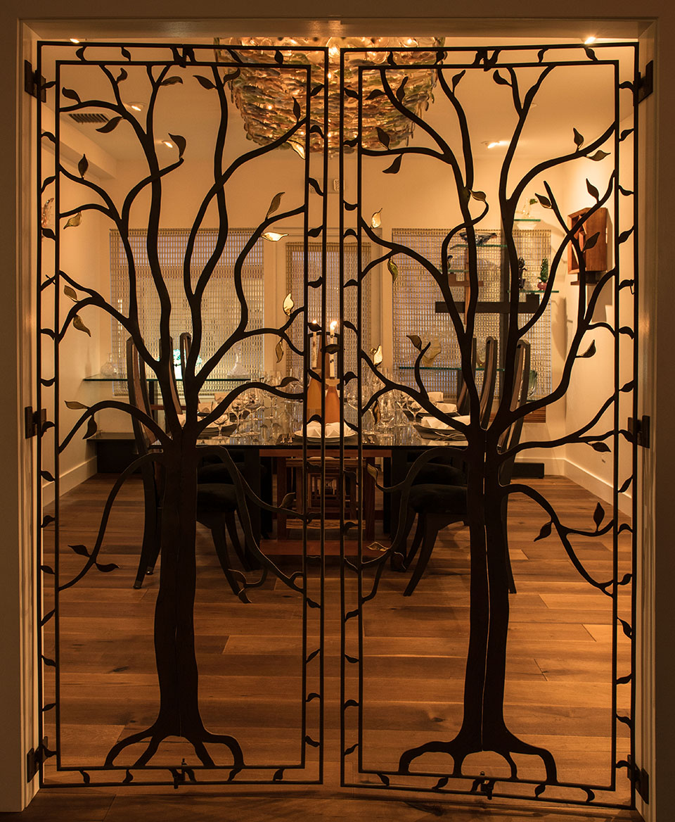 The artsy doors to 1921's private dining room; Photography by Debi Harbin