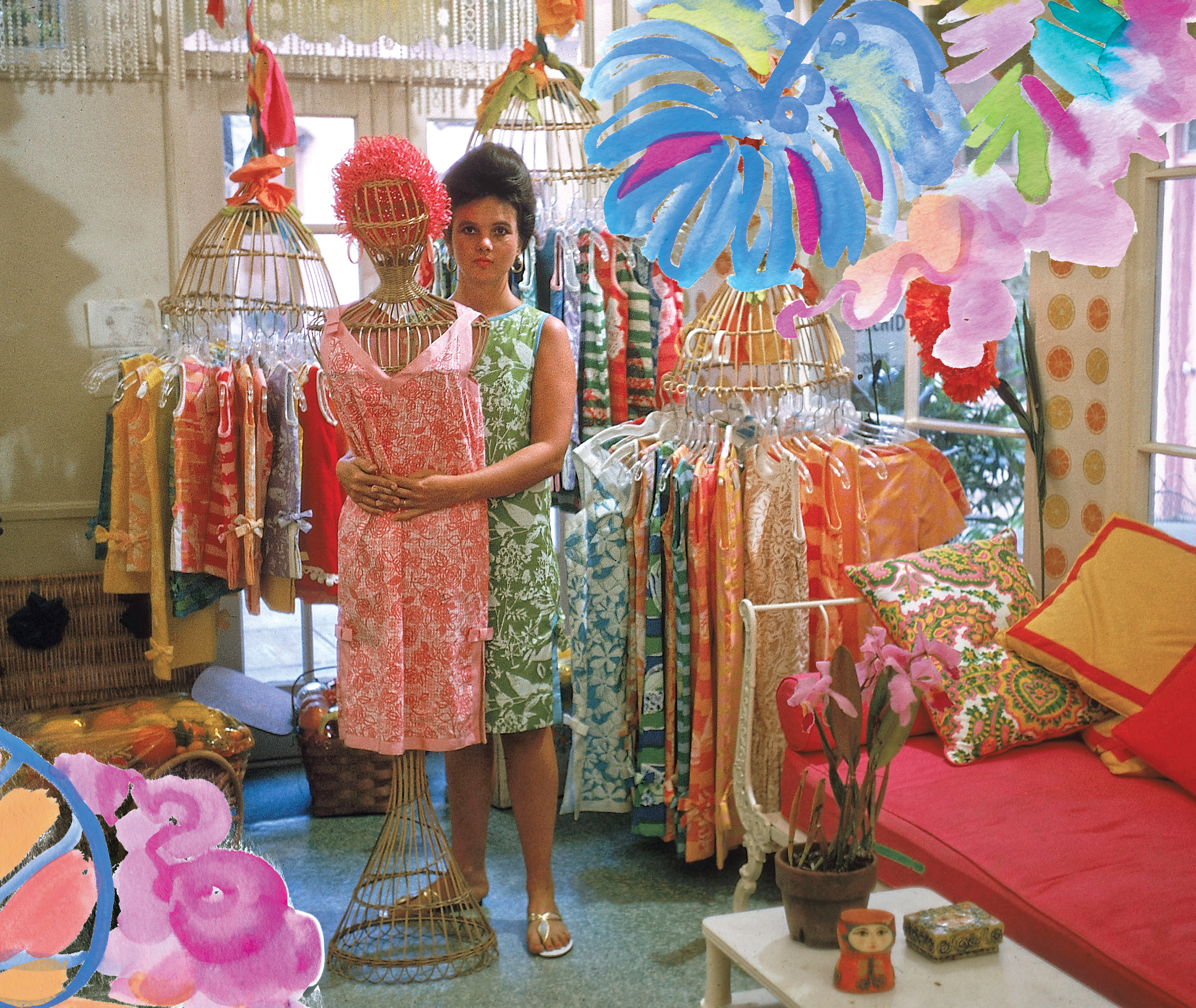 Lilly Pulitzer stands in her first shop. It is colorful and full of racks of dresses. A coach is visible. Lilly herself wears green shift dress and her hair up and hugs a rattan mannequin wearing a pink shift dress. Watercolor Lilly patterns are overlaid on the photos borders.