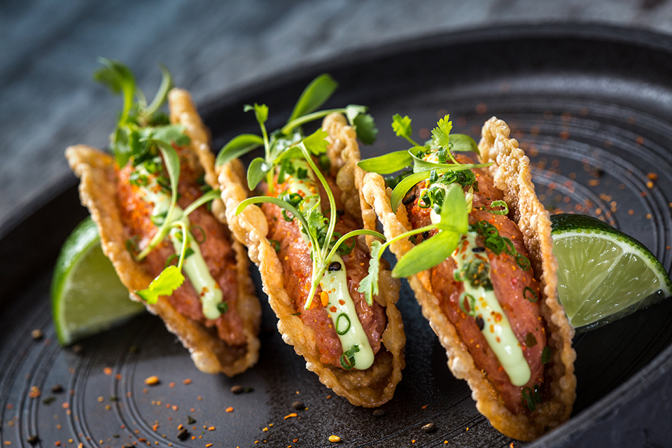 Tuna taco made with spicy tuna, creamy avocado and fresh cilantro. Photography by Benjamin Rusnak