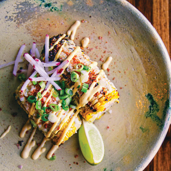 Add pizzazz to grilled street corn with passion fruit mayo. Photography by Alex Celis