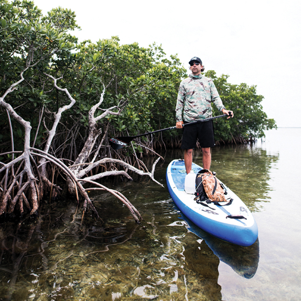 Gabriel Gray in Keys' mangroves searching for sawfish; All research activities were conducted under ESA permit 17787 & ENP permit EVER-2017-SCI-0022. Photography by Desirée Gardner