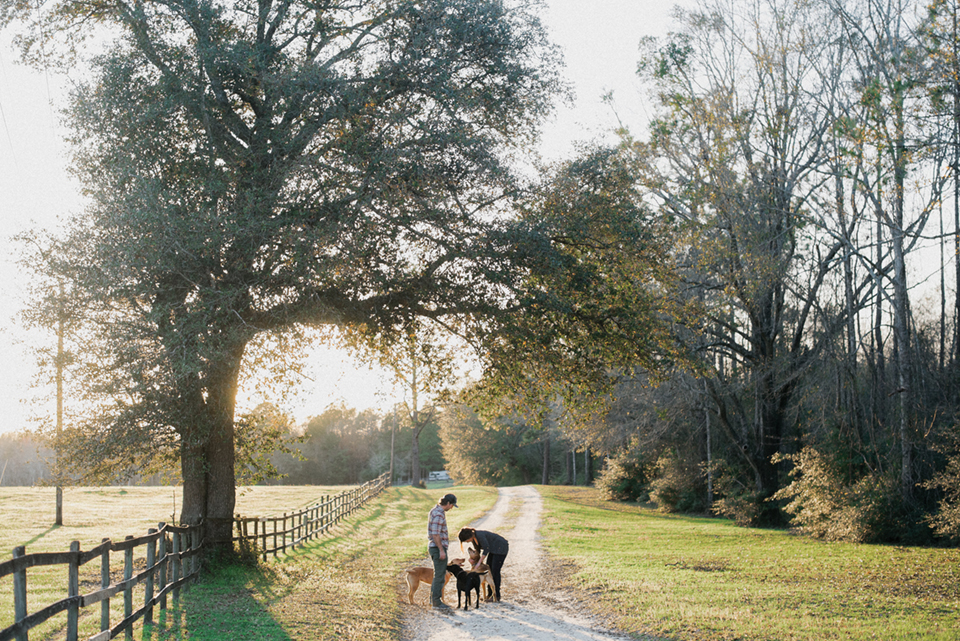 Gray on his farm with his wife Natalie and their dogs, walking to catch a sunset; Photography by Desirée Gardner