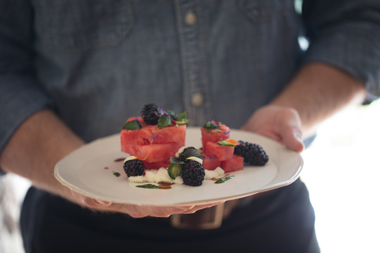 Florida watermelon salad with goat cheese, pickled blackberries, basil puree, serrano lemon vinaigrette and pomegranate molasses; Photography by Libby Volgyes