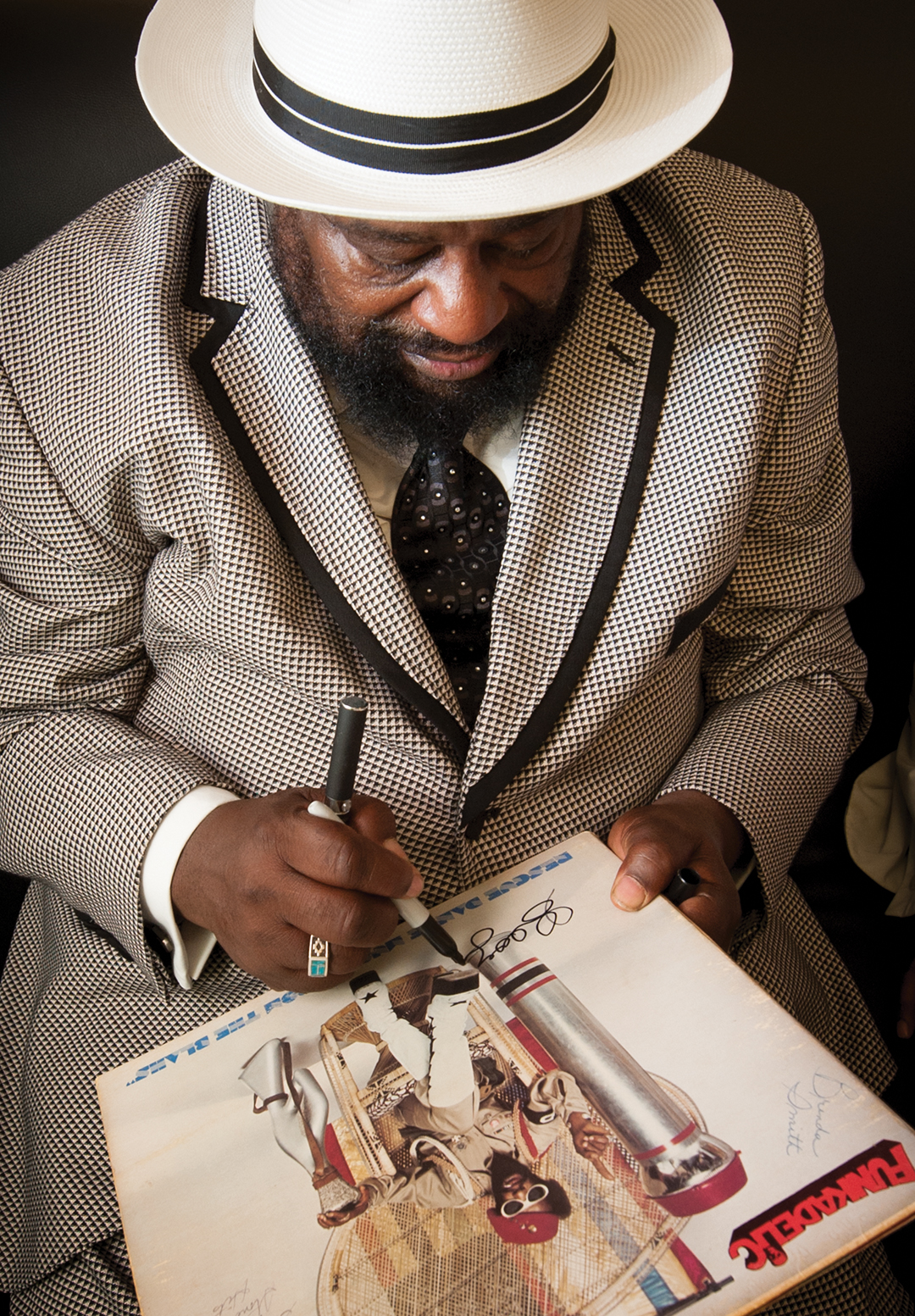 George Clinton signing one of his records