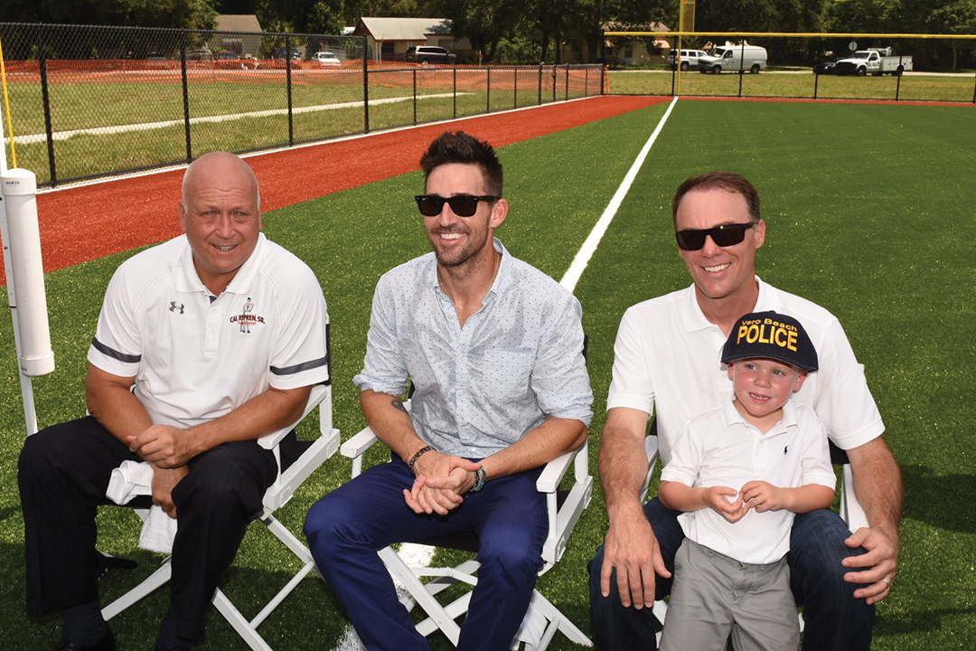 Owen with Cal Ripken Jr. and NASCAR driver Kevin Harvick at the ribbon cutting of Jake Owen Field, which serves the youth of Vero Beach