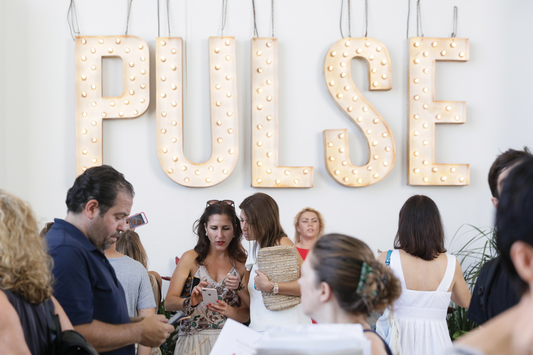 attendees gather at the entrance to the Pulse fair during Miami Art Week 2017