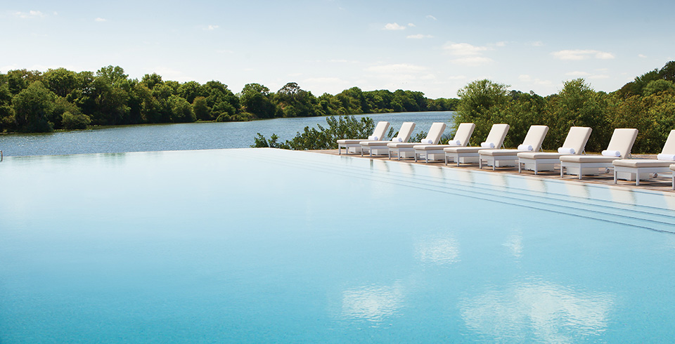 The natural setting and the luxurious amenities like the outdoor pool promote a sense of serenity.