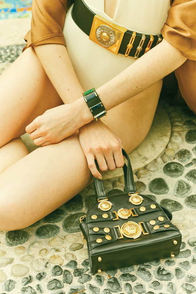 A close-up of Krystoff by the pool wearing the black and hold belt.
