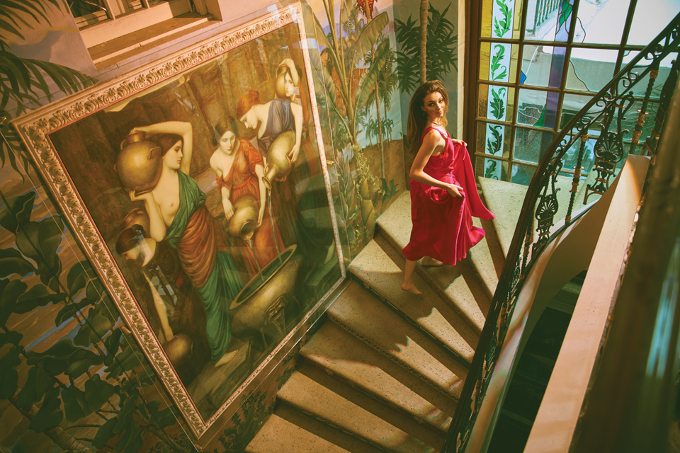 Krystoff climbs up stairs in the Versace house.