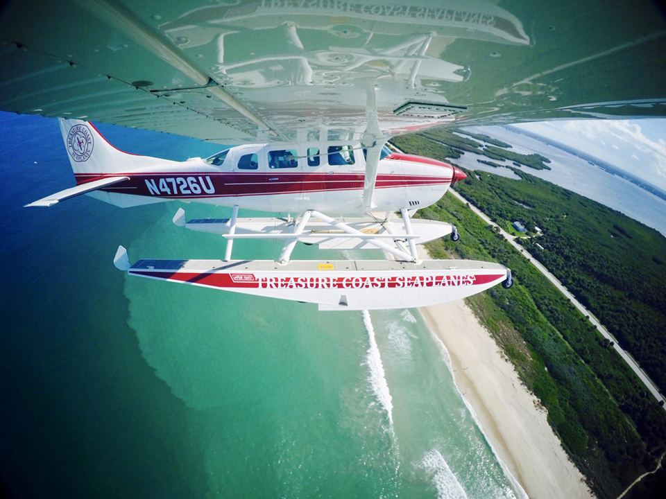 Nothing like taking to the skies and the water at Sebastian Inlet with Treasure Coast Seaplanes! Seaplane over a coast.