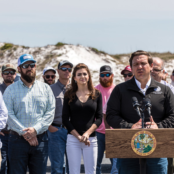 Governor DeSantis giving a speech in front of the everglades on wildlife protection.