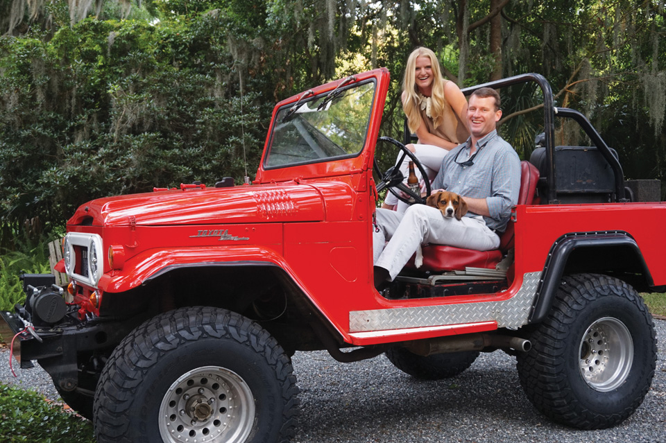 Cannon Gaskin and his wife Carolyn in a vintage Red FJ Cruiser.