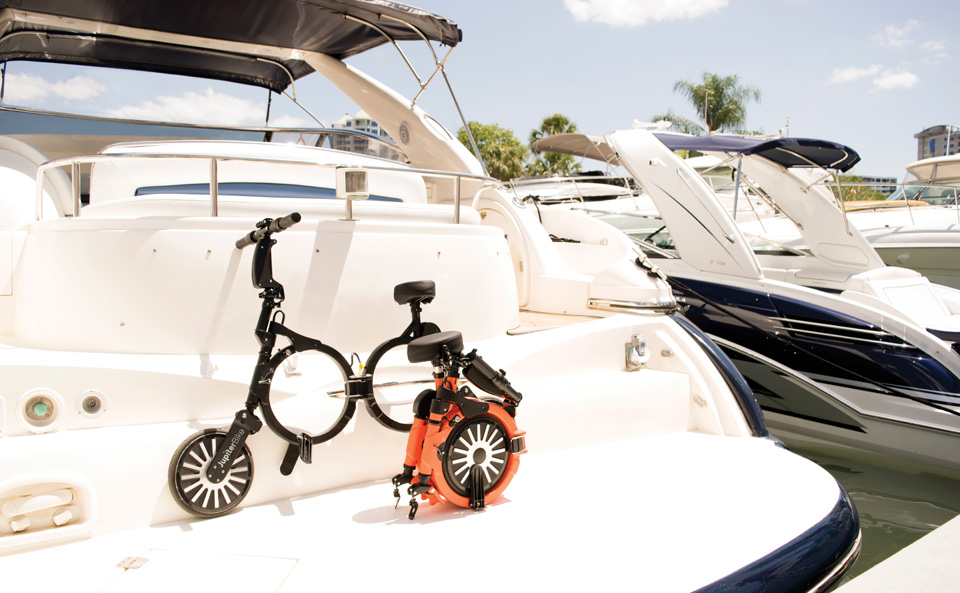 Two Jupiter Bikes, one open and one folded on the back of a Boat.