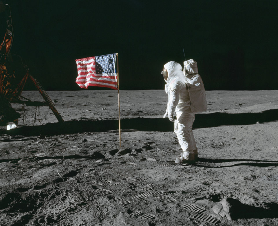 Astronaut Ed Aldrin poses for a photo beside the U.S. flag that has been placed on the moon at Tranquility Base during the Apollo 11 Mission.