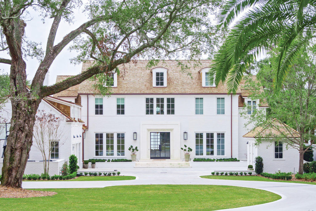 The Jacksonville home is classically proportioned in keeping with the historic neighborhood, with a steel and glass front door opening to a river view