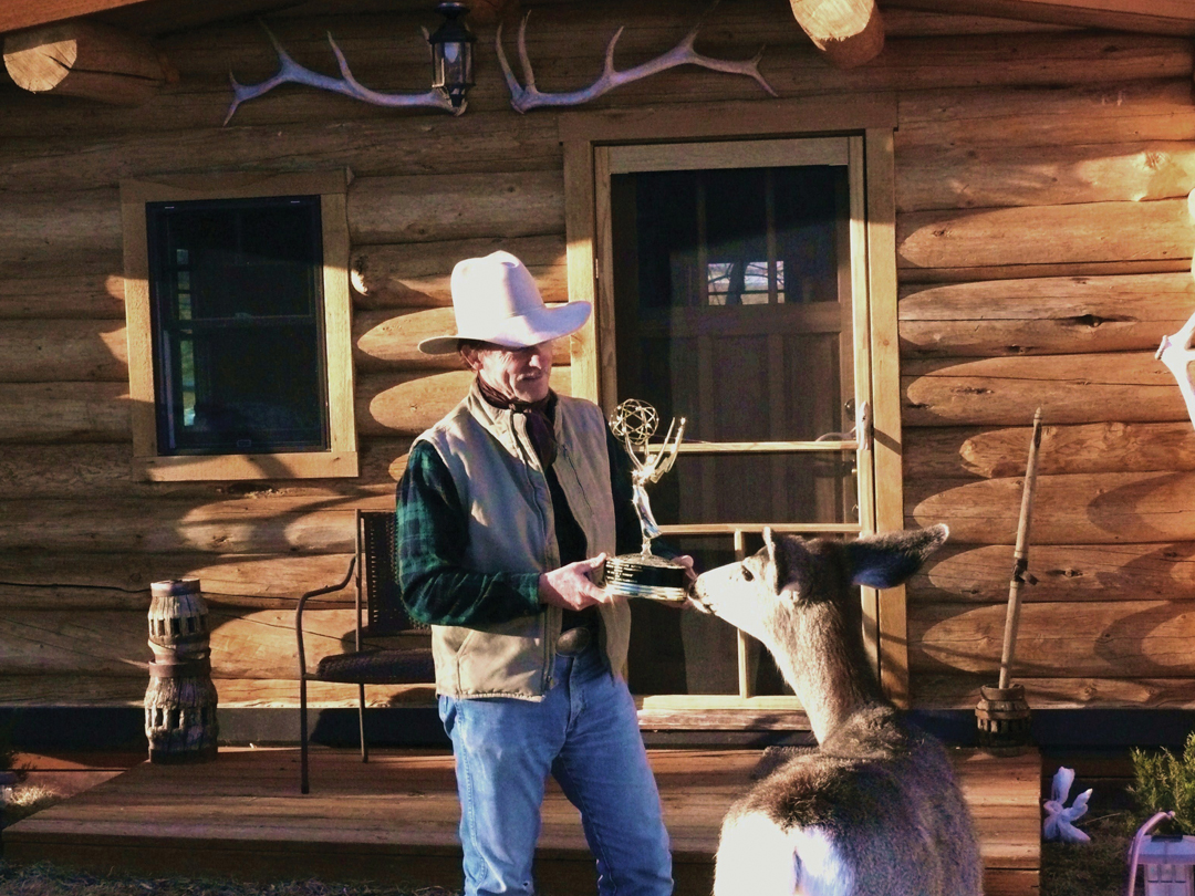 "Hutto and mule deer ""Peep"" examining Hutto's Emmy in 2013"