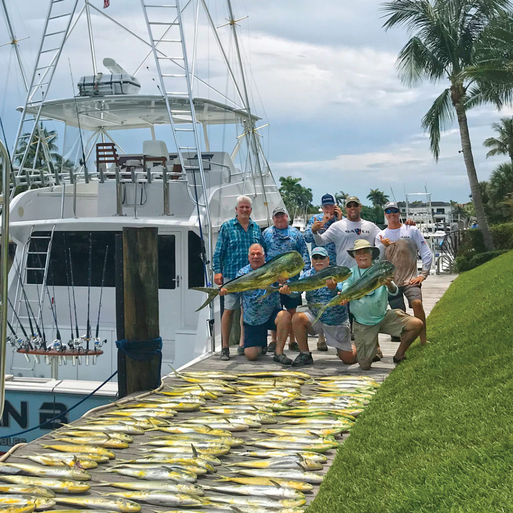 Barreto and friends after a successful day on the water catching mahi-mahi