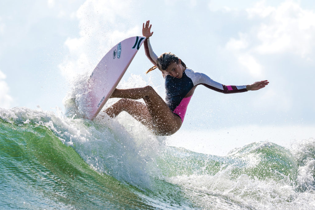 Zoe Benedetto riding a wave