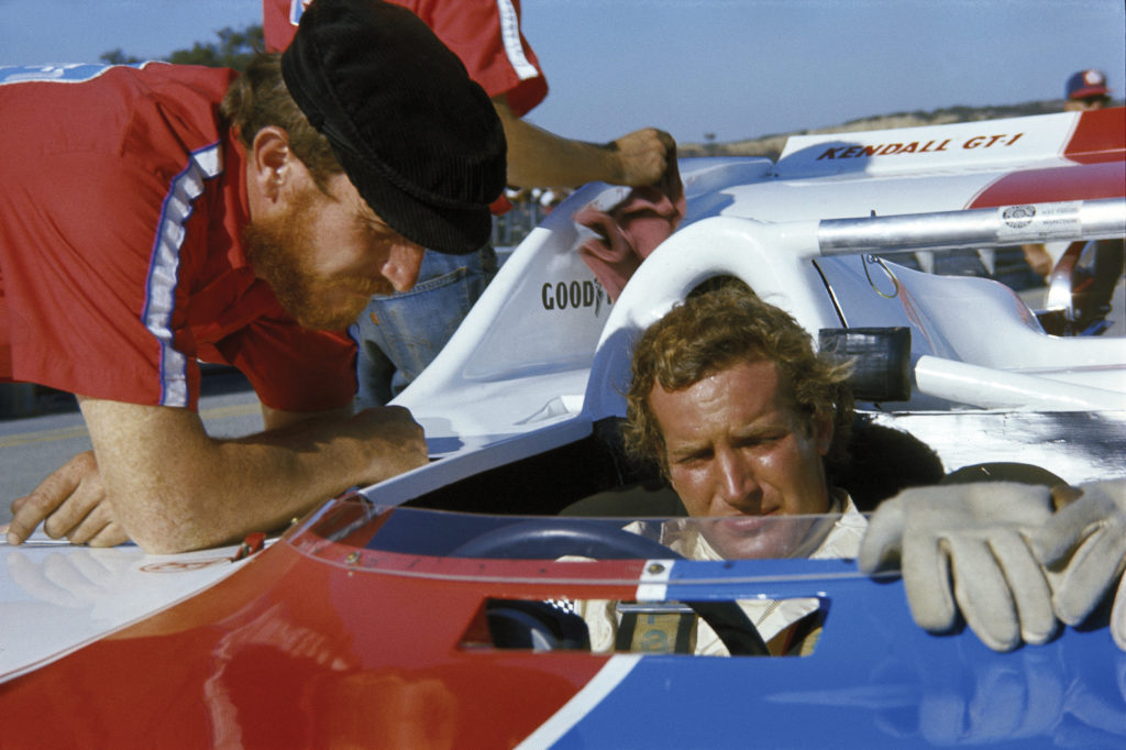 Haywood sits down in his car, the Porsche 917-10