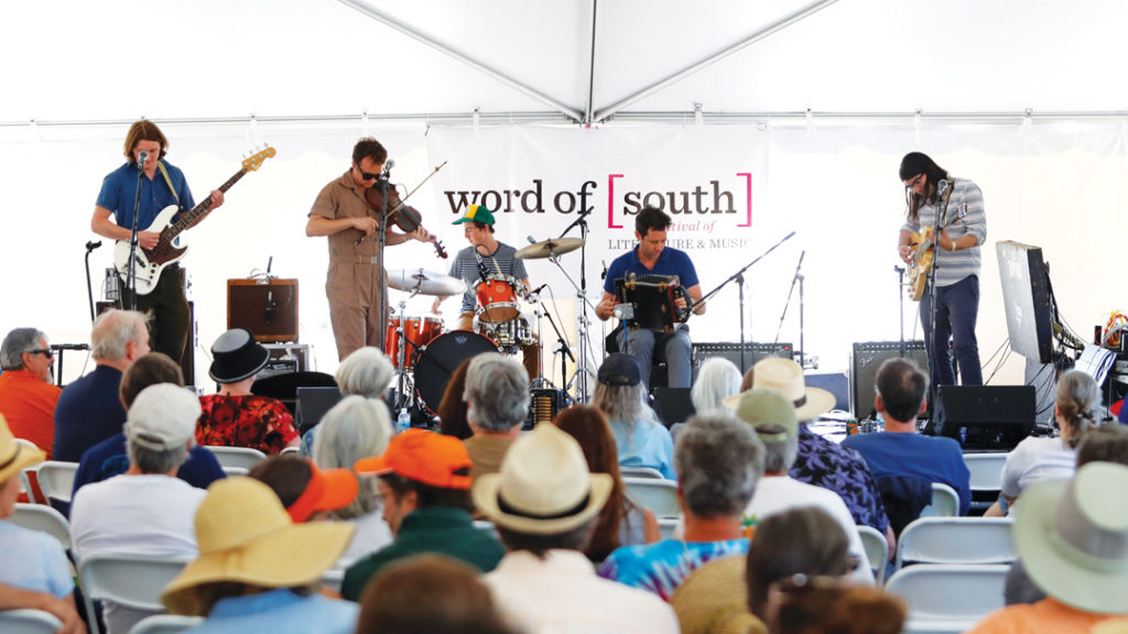 word of south stage with band
