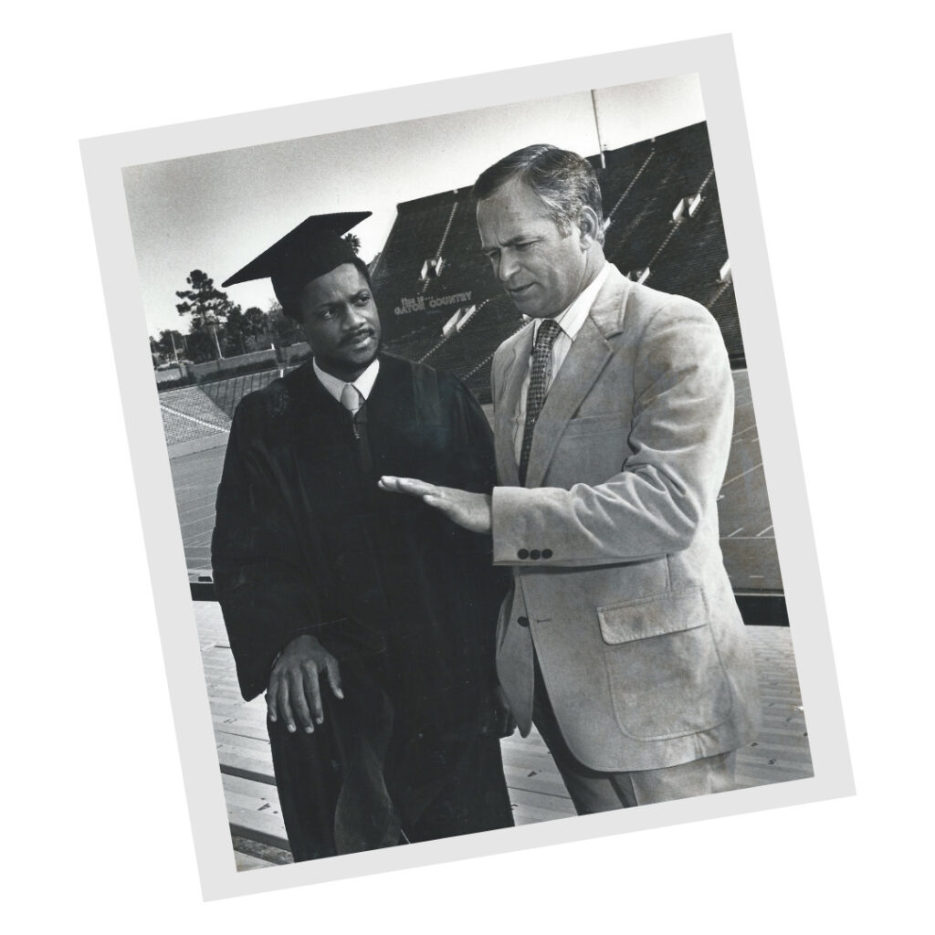 Leonard George in a cap and gown at UF.