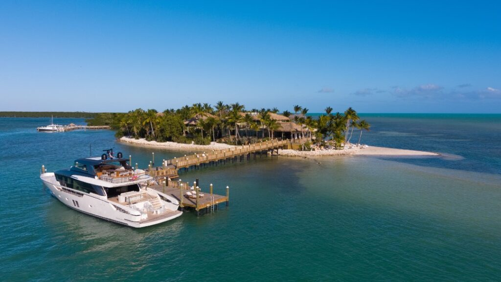 A boat is docked at Little Palm Island. The small island is aptly named, as it's covered in palms.