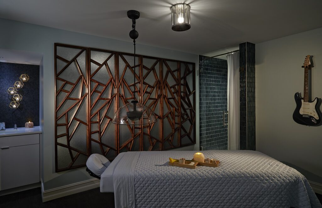 A massage room at the Hard Rock Hotel Daytona Beach. An electric guitar hangs on the wall.