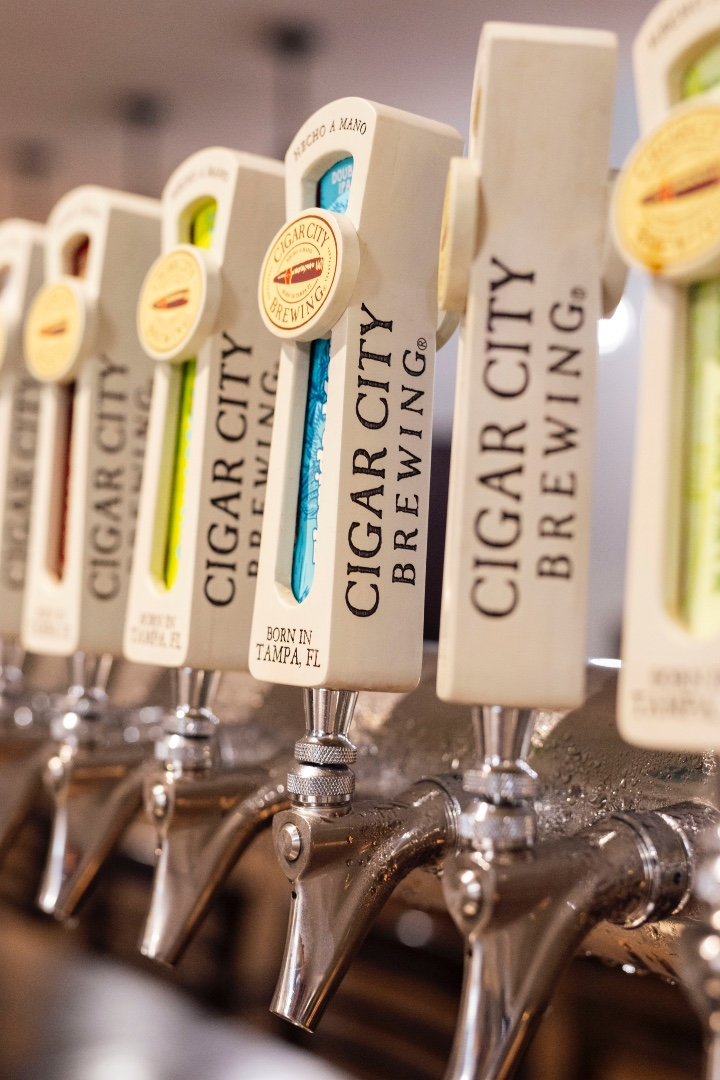 A close-up of Cigar City Brewery taps.